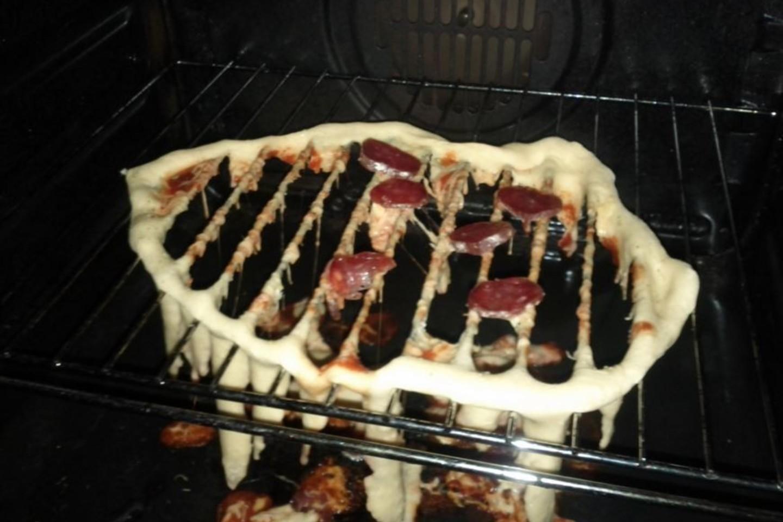 Akivaizdu, kad dėti picą ant grotelių nėra pati geriausia idėja.<br>wildbeastly.tumblr.com nuotr.