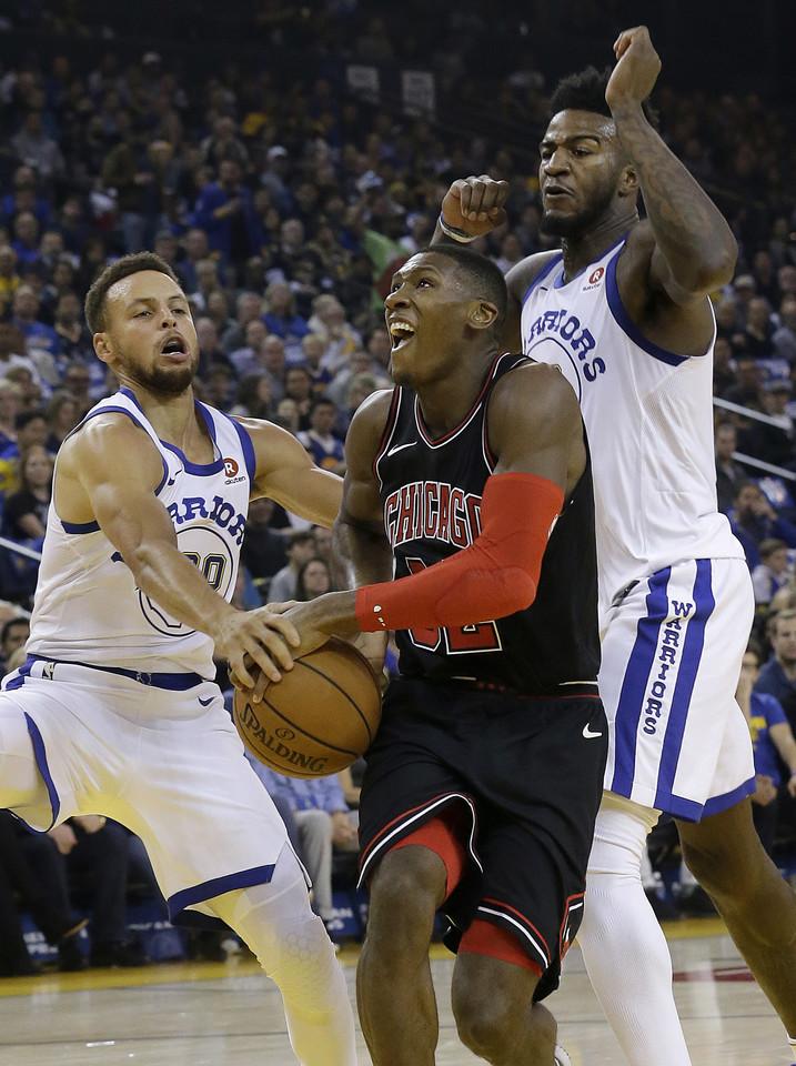 """""""Warriors"""" krepšininkai sutriuškino """"Chicago Bulls"""" komandą 143:94.<br>AP nuotr."""