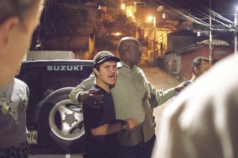 Pastorius Alvinas (dešinėje) atvyko iš Amerikos į Hondūrą ir siekia padėti priklausomybių turintiems žmonėms, skurde skendinčioms prostitutėms.<br>E.Benites nuotr.