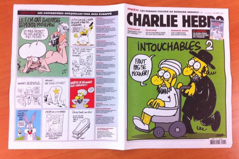 """""""Charlie Hebdo"""" redakcija buvo užpulta dėl leidinyje spausdintų pranašo Muhammado karikatūrų.<br>""""Scanpix"""" nuotr."""