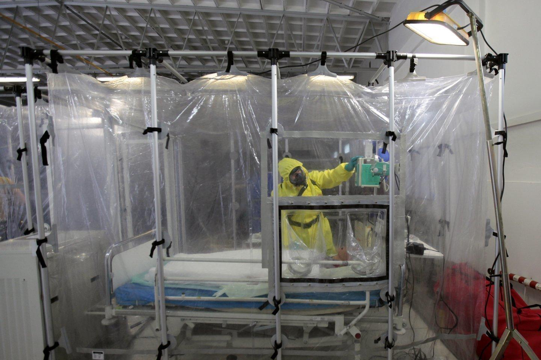 Koronaviruso protrūkis paskelbtas pandemija.<br>Scanpix nuotr.