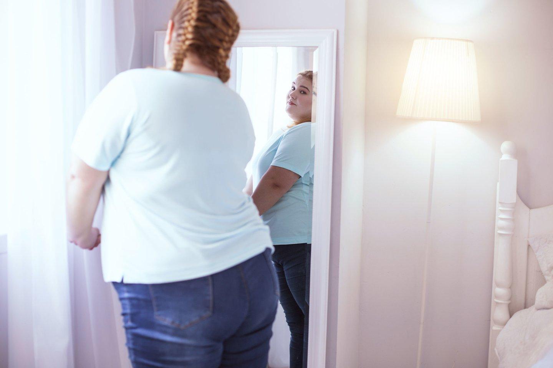 Nutukimas yra didžiausias COVID-19 sergančių pacientų poreikio hospitalizuoti ir kritinės ligos būklės veiksnys.<br>123rf nuotr.
