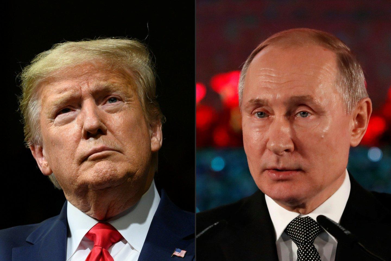 """JAV prezidentas Donaldas Trumpas ketvirtadienį kalbėdamasis telefonu su Rusijos lyderiu Vladimiru Putinu paragino į naujas ginklų kontrolės derybas su Maskva įtraukti Kiniją, siekiant išvengti """"brangių ginklavimosi varžybų"""", pranešė Baltieji rūmai.<br>AFP/Scanpix nuotr."""