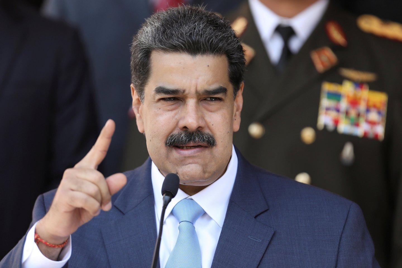 """Venesuelos opozicijos nariai spalio mėnesį sudarė beveik 213 mln. dolerių (197,5 mln. eurų) vertės kontraktą su amerikiečių kompanija """"Silvercorp USA"""" dėl įsiveržimo į šalį ir prezidento Nicolas Maduro nuvertimo, rodo dokumentas, kurį paskelbė JAV laikraštis """"The Washington Post"""".<br>Reuters/Scanpix nuotr."""