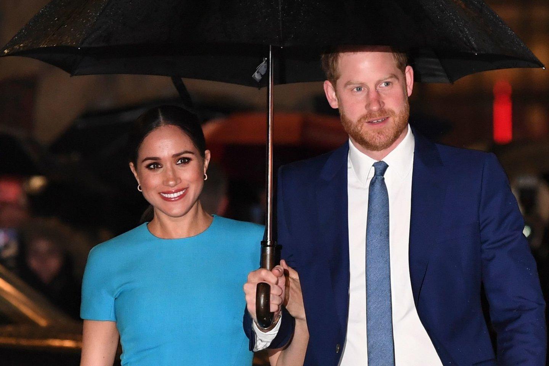 Meghan Markle ir princas Harry.<br>Scanpix/AFP nuotr.