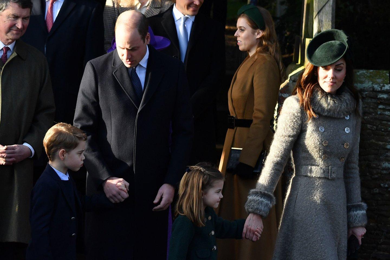 Prie vaikų auklėjimo prisideda abu tėvai.<br>AFP/Scanpix nuotr.