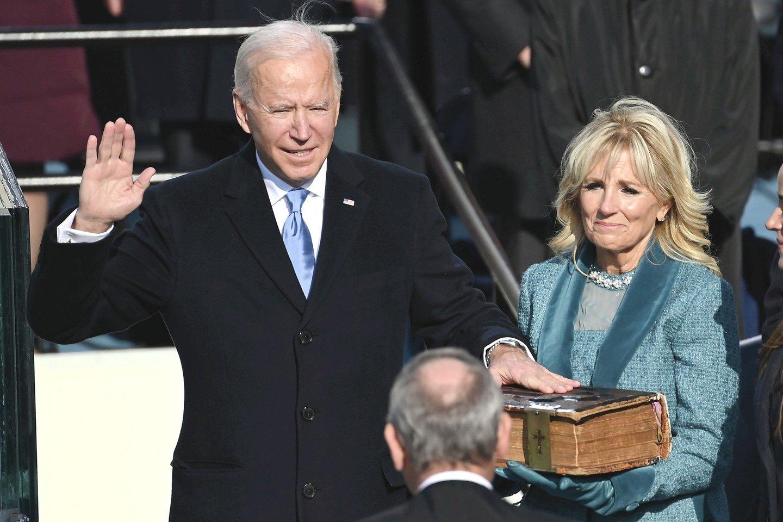"""Prezidento J.Bideno ir viceprezidentės K.Harris inauguracija tapo istoriniu įvykiu, daugeliui JAV gyventojų leidusiu atsikvėpti ir sugrąžinusiu viltį.<br>AP/""""Scanpix"""" nuotr."""