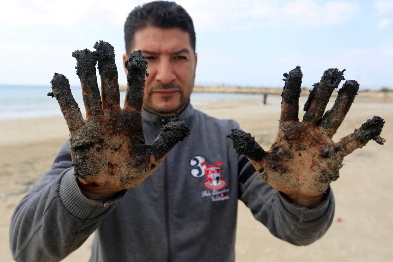 Ekologinė nelaimė prie Izraelio krantų.<br>Scanpix/AFP/FP/Reuters nuotr.