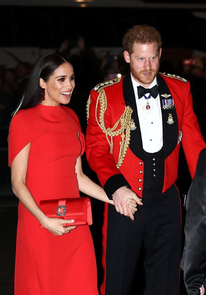 Meghan Markle ir princas Harry.<br>PA Wire/PA Images/Scanpix nuotr.