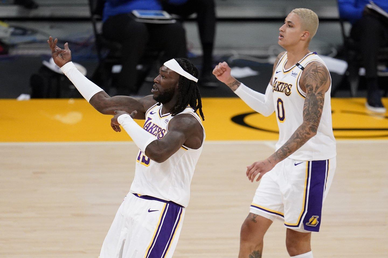 NBA čempionai šventė sunkią pergalę namuose.<br>Scanpix nuotr.