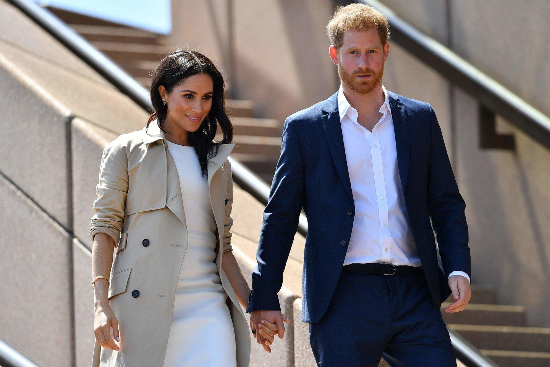 """Karališkosios šeimos biografė prakalbo apie kritikuojamą Meghan Markle: """"Ji norės grįžti ir kovoti"""".<br>Scanpix/AFP nuotr."""