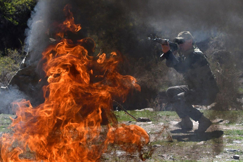 Kirgizija praneša apie 13 žuvusiųjų per susirėmimus pasienyje su Tadžikistanu.<br>AFP/Scanpix nuotr.
