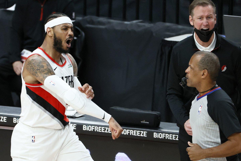 C.Anthony pakilo į rezultatyviausių visų laikų NBA žaidėjų dešimtuką.<br>AFP/Scanpix nuotr.