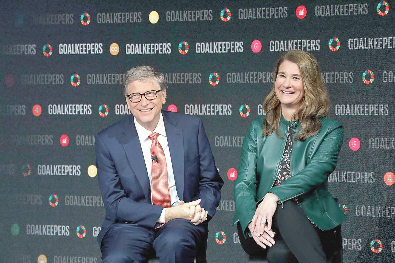 """Viena turtingiausių pasaulio porų B. ir M.Gatesai santuokoje pragyveno 27 metus, užaugino tris vaikus.<br>AFP/""""Scanpix"""" nuotr."""