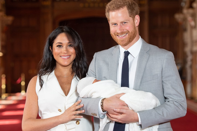 M.Markle, princas Harry ir jų sūnus Archie.<br>AFP/ Scanpix nuotr.