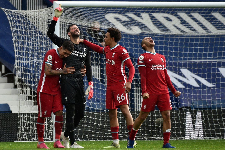 """Vartininko įvartis atneš svarbią """"Liverpool"""" pergalę.<br>AFP/Scanpix nuotr."""