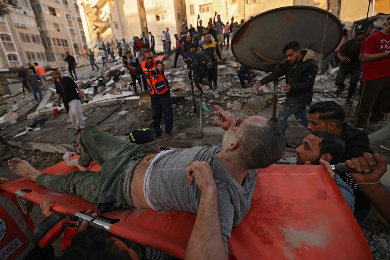 Gazos Ruože tęsiasi Izraelio smūgiai, konfliktui nusinešus per 200 gyvybių.<br>AFP/Scanpix nuotr.