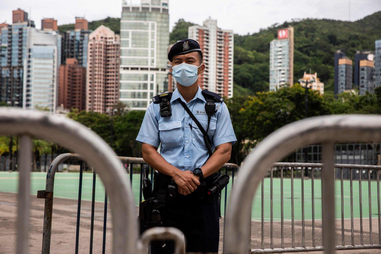 """Honkongas cenzūruos filmus, """"keliančius pavojų nacionaliniam saugumui"""". <br>ISAAC LAWRENCE / AFP / Scanpix nuotr."""