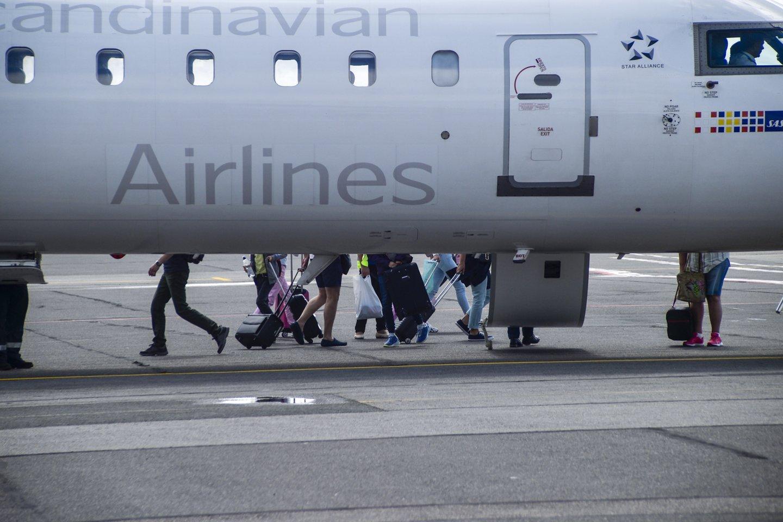 Palangos oro uostas,lėktuvai,keleiviai,išvykimas,atvykimas,emigrantai<br>V.Ščiavinsko nuotr.