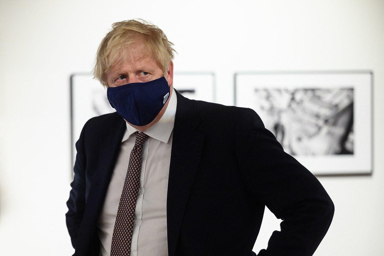 JK pirmą kartą per keturis mėnesius paros laikotarpiu užfiksuota daugiau nei 10 tūkst. COVID-19 atvejų.<br>AFP/Scanpix nuotr.