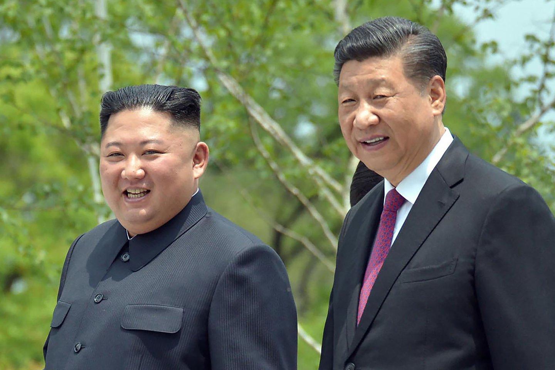 Kinija yra ilgametė Šiaurės Korėjos sąjungininkė ir ekonomikos rėmėja.<br>AP/Scanpix nuotr.