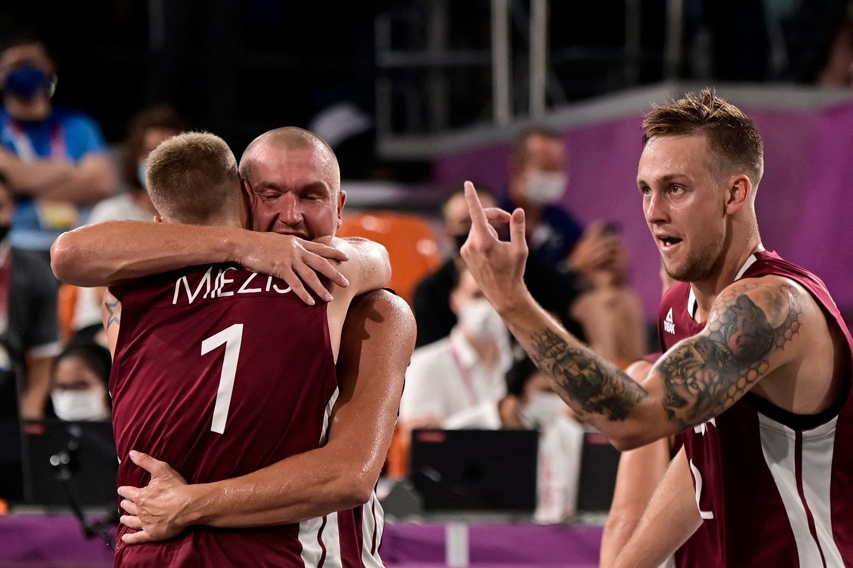 Latvijos krepšininkai tapo olimpiniais čempionais.<br>AFP/Scanpix nuotr.