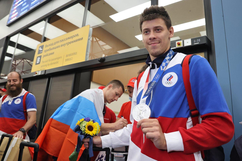 Rusijos sportininkai dalyvauja Tokijo žaidynėse ir jų yra net 330, nors oficialiai jie varžytis negali.<br>AFP/Scanpix.com nuotr.