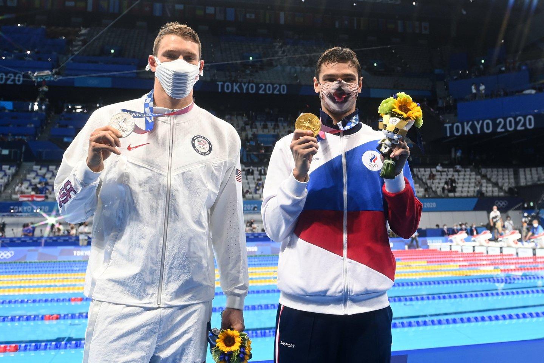 Jevgenijų Rylovas ir amerikietis Ryanas Murphy <br>AFP/Scanpix.com nuotr.