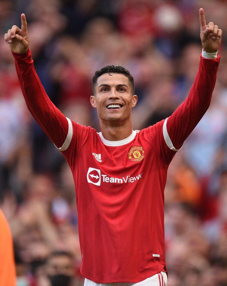 Cristiano Ronaldo tapo daugiausiai pinigų per metus gaunančiu futbolininku.<br>AFP/Scanpix nuotr.